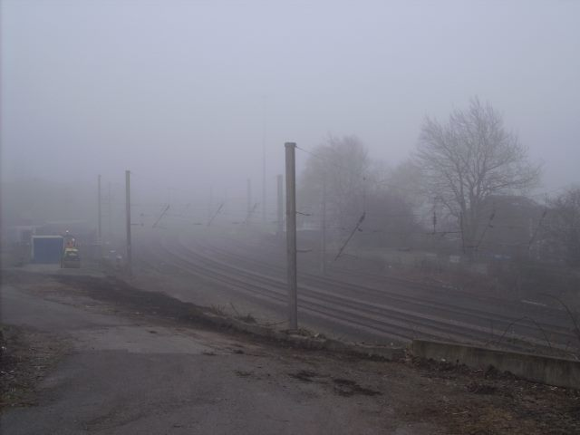 Railway workers shrouded in mist. you can hear 'em, but you can't see 'em.