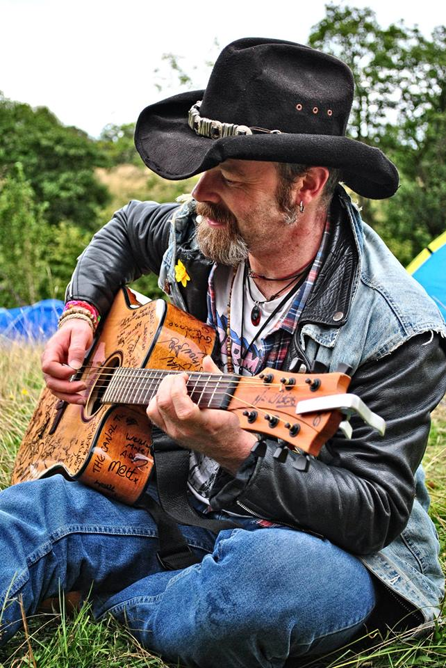 "A cowboy and his guitar... collecting signatures on ""The Torch"" guitar at Farmfest, 23/08/2014. Pic by Gav Wyatt."